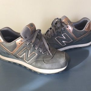 New Balance 574 Rose gold and grey sneakers.